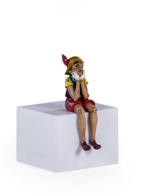 Antiqued Sitting Pinocchio Figure